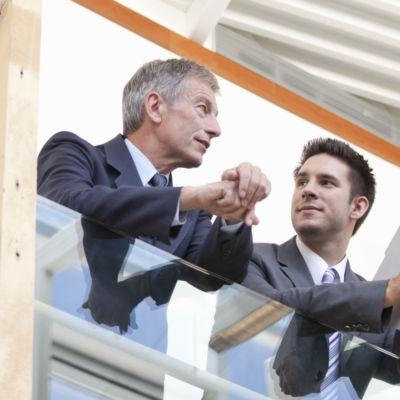 Businessmen having conversation in modern office